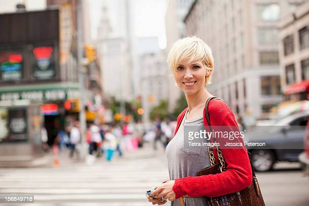 USA, New York State, New York, Portrait of woman on street.