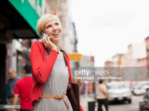 USA, New York State, New York, Woman smiling and talking on phone.