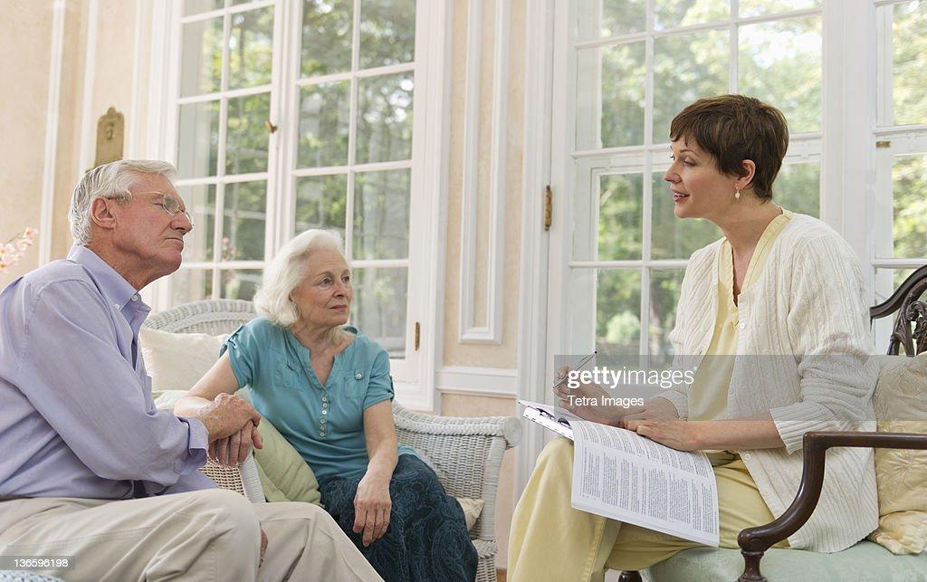 Usa New York State Old Westbury Senior Man And Nurse Talking In