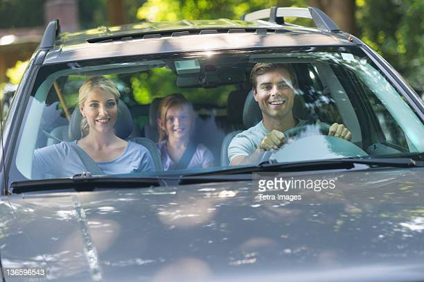 USA, New York State, Old Westbury, Parents with daughter (10-11) driving car
