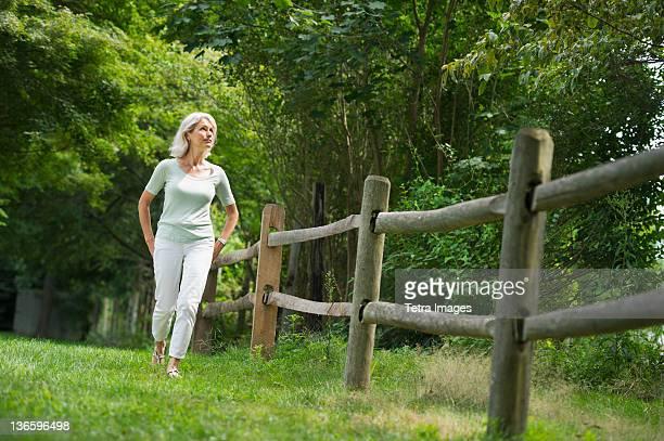 USA, New York State, Old Westbury, Senior woman walking