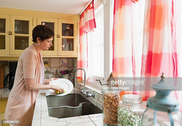USA, New York State, Old Westbury, Woman washing dishes