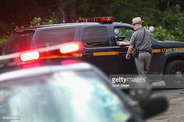 New York State Police man a roadside checkpoint as the search continues for convicted murderers Richard Matt and David Sweat on June 23 2015 near...