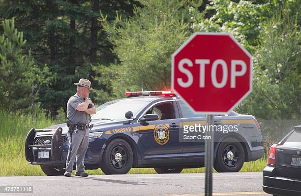 New York State Police officers man a roadblock along Highway 30 as the manhunt for escaped convict David Sweat continues on June 27 2015 near Malone...