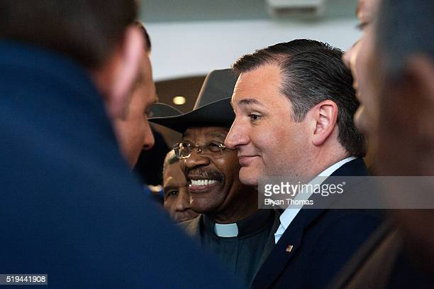 New York State Senator Ruben Diaz and Republican presidential candidate Ted Cruz pose for pictures at the restaurant Sabrosura 2 on April 6 2016 in...