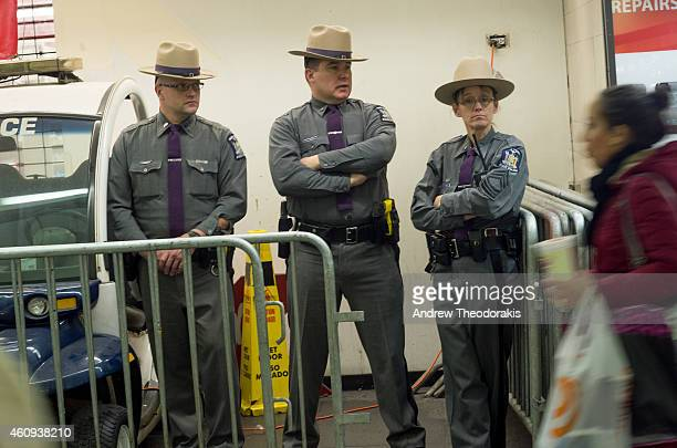 New York State Troopers stand watch inside Penn Station on December 31 2014 in New York City With an estimated one million people packing into Times...