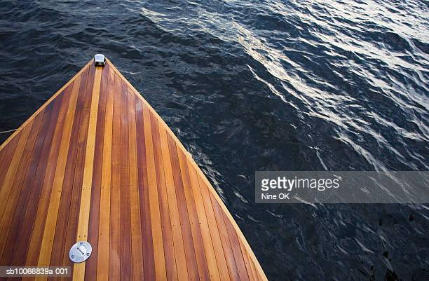 USA, New York State, wooden bow of boat on water, elevated view