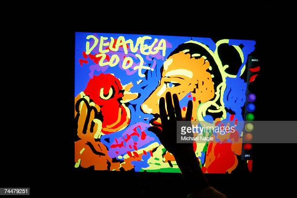 New York Street Artist James De La Vega demonstrates the painting feature of Microsoft Surface at the Sheraton New York Hotel Towers June 9 2007 in...