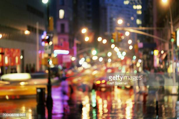 USA, New York, street scene in rain illuminated at night