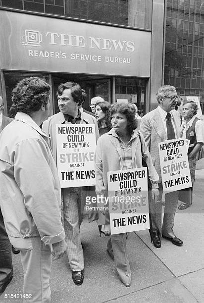 Striking employees of the New York Daily News walk picket like outside the Daily News Building after some 1300 workers walked off the job in a...