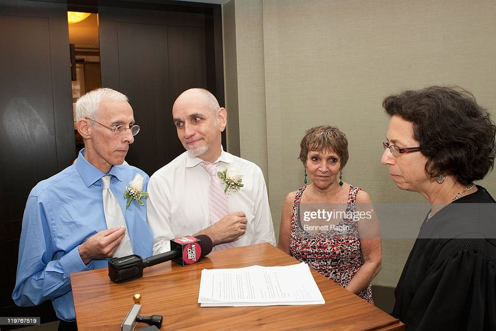 New York Supreme Court Judge Ellen Gesmer (R) performs the nuptials for Frank Faria (L) and Randy Faria during the first day of legal same-sex marriage in New York State on July 24, 2011 in New York City.