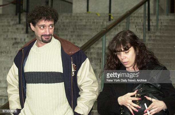 New York talk show host Anthony Cumia and his wife walk out of Supreme Court after a settlement in their divorce proceedings Cumia is cohost of the...