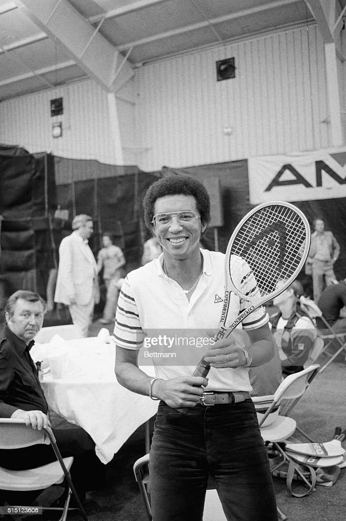 Tennis great <a gi-track='captionPersonalityLinkClicked' href=/galleries/search?phrase=Arthur+Ashe&family=editorial&specificpeople=215183 ng-click='$event.stopPropagation()'>Arthur Ashe</a> seems almost out of place with street clothes and a tennis racket, but he was on hand at the U. S. Open Tennis Championships in Flushing Meadow 8/30, as he made his first public appearance since suffering what was called a mild heart attack on 7/30. Ashe, 36, was promoting a line of sporting goods as he held a press conference here. 'I'm feeling very good,' he said. 'I can walk around now,' and he added, 'it feels good to be able to make my first public appearance, that's for sure.'