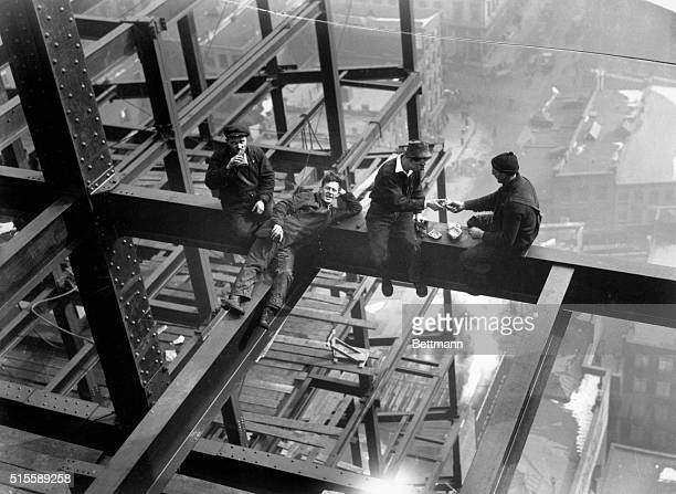 The new telephone company skyscraper at Vesey Street and the North River under construction Photo shows the iron workers perched on a girder twenty...
