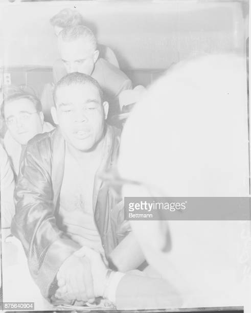 The Picture Of DefeatFollowing his defeat at the hands of Rocky Marciano tonight exheavyweight champion Joe Louis cries sadly in his dressing room at...