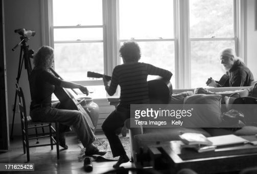 USA, New York, Three people playing together