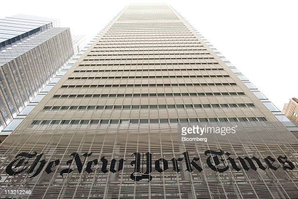 New York Times Co signage is displayed on the company's building in New York US on Wednesday April 27 2011 New York Times Co publisher of the...