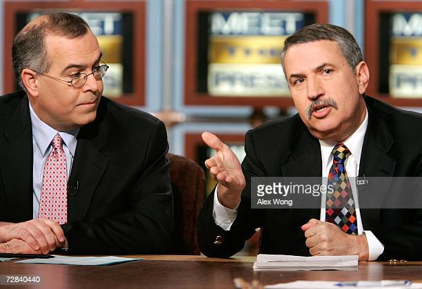 New York Times columnists Tom Friedman and David Brooks participate in a discussion during a taping of 'Meet the Press' at the NBC studios December...