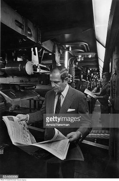 New York Times publisher Arthur Sulzberger reads the paper hot off the press August 25 1976 in New York City