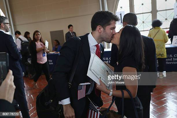 New York Times reporter Alex Burns congratulates his wife and CNN reporter MJ Lee from South Korea after she became an American citizen during a...