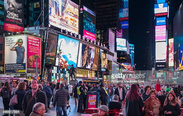 New York Times Square night scenes featuring the crowd and neon ads The tourist landmark is visited by about 50 million tourists every year and is...