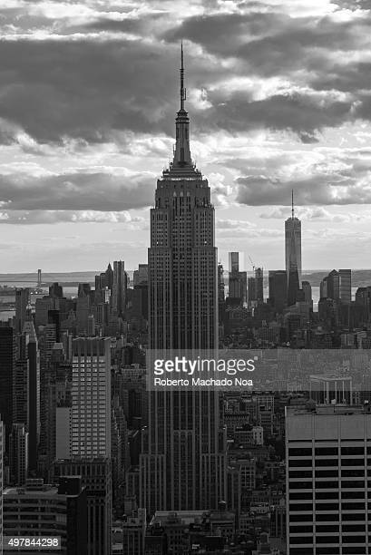 New York tours and attractions Empire state building pictured in black and white or grayscale Generally thought of as an American cultural icon...