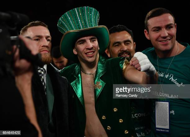 New York United States 17 March 2017 Michael Conlan centre with Conor McGregor and Matthew Macklin after defeating Tim Ibarra in their featherweight...