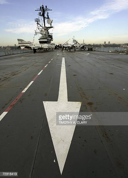 A arrow points the way on the launch flight deck on the retired aircraft carrier USS Intrepid 31 October 2006in New York The aircraft carrier that...