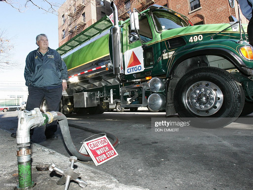 A CITGO delivery truck delivers low cost heating oil to a cooperative apartment building 17 November, 2006 in the Bronx, New York. The delivery was the initial low-cost heating oil of the CITGO-Venezuela heating oil program to the 60-unit building. AFP PHOTO/DON EMMERT