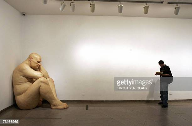 A giant sculpture titled 'Big Man' by Australianborn artist Ron Mueck is on display at the Brooklyn Museum 31 January 2007 Mueck has on exhibit a...