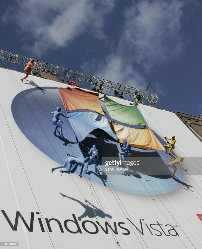 A group of performers from the Grounded Aerial Dance Theater hang from a seven-story tall building as part of the Microsoft Windows Vista operating system launch, 29 January 2007, in New York. The new Windows Vista will be available to consumers on 30 January. AFP PHOTO/Stan HONDA