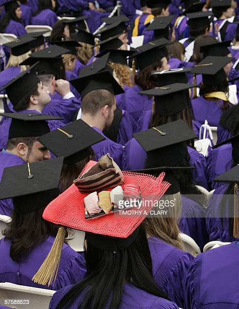 A Japanese graduating student from the New York University Class of 2006 dresses up her cap and gown with a fake plate of sushi at Washington Square...