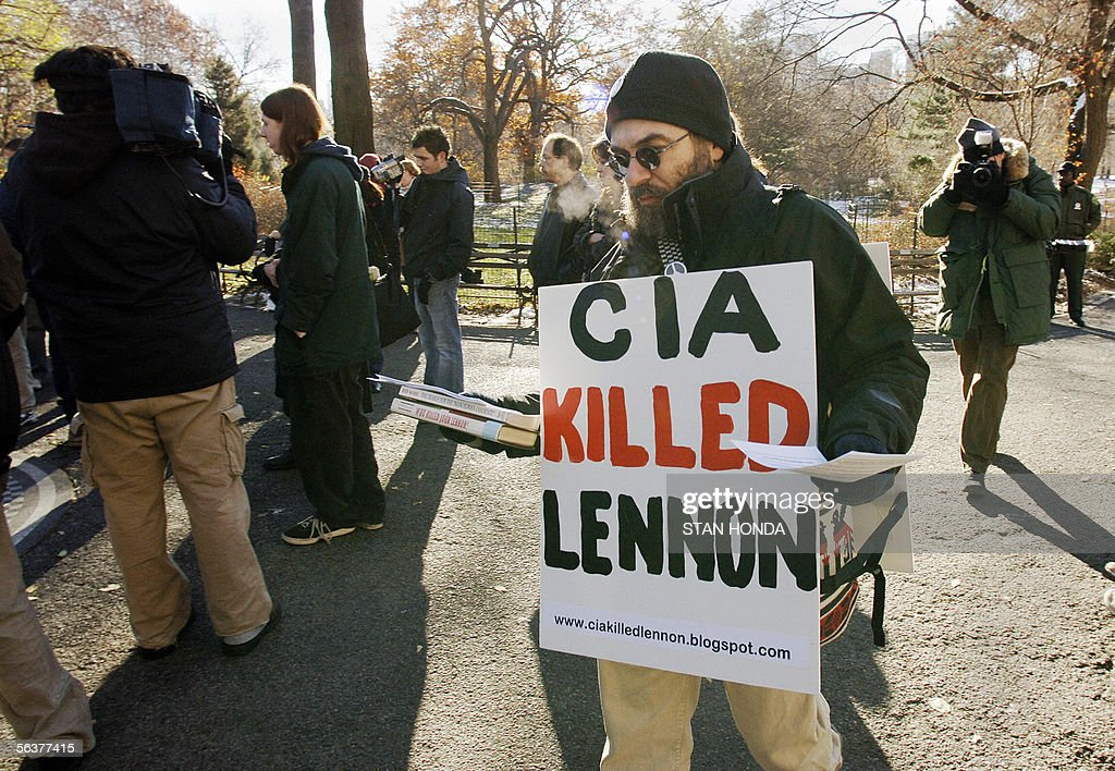 A man who gave his name as 'Alan' carries a sign and hands out literature claiming the CIA killed the late Beatle John Lennon as fans gather on the...