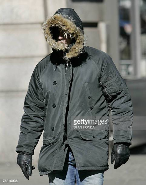 A man's face is almost hidden by his hood to protect from the bitter cold 05 February 2007 in the Brooklyn borough of New York City Noon time...