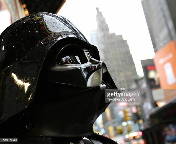 A performer dressed as Darth Vader stands on Broadway in Times Square before the start of a press conference 13 October to announce the new Star Wars...