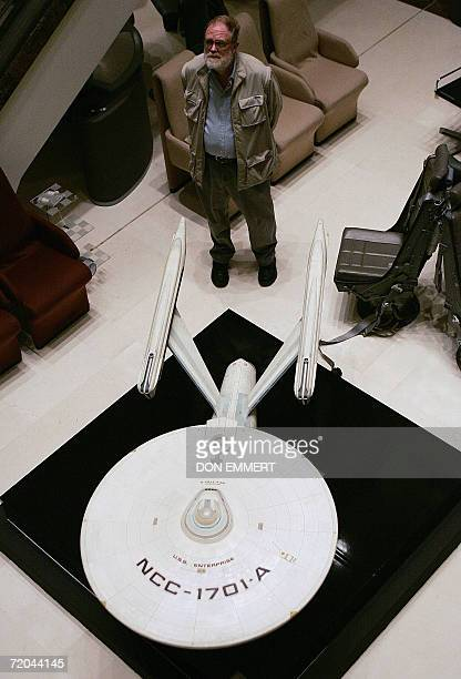 A reporter stands next to a model of the Starship USS Enterprise from the 'Star Trek' television and movie series 29 September 2006 at Christie's in...