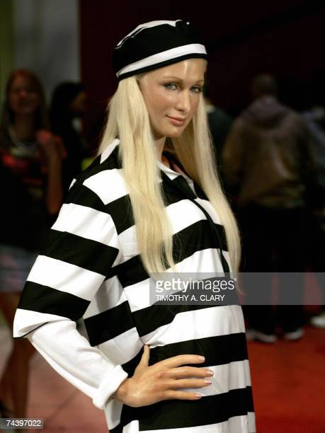 A wax figure of Paris Hilton dressed in a black and white striped jailbird suit on display on the red carpet at Madame Tussauds New York 04 June 2007...