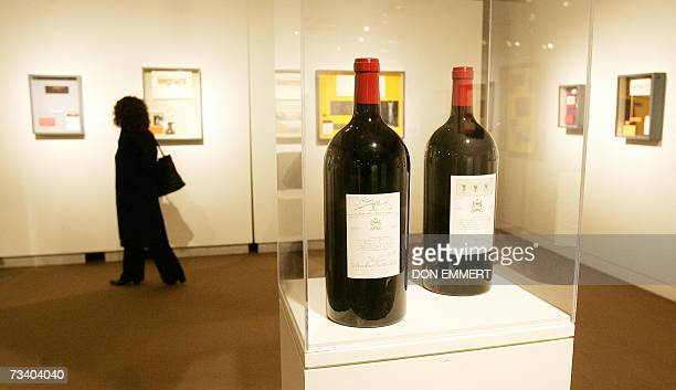A woman looks at paintings created for labels of Chateau Mouton Rothschild 23 February 2007 at Sotheby's in New York The exhibit has 60 vintages from...