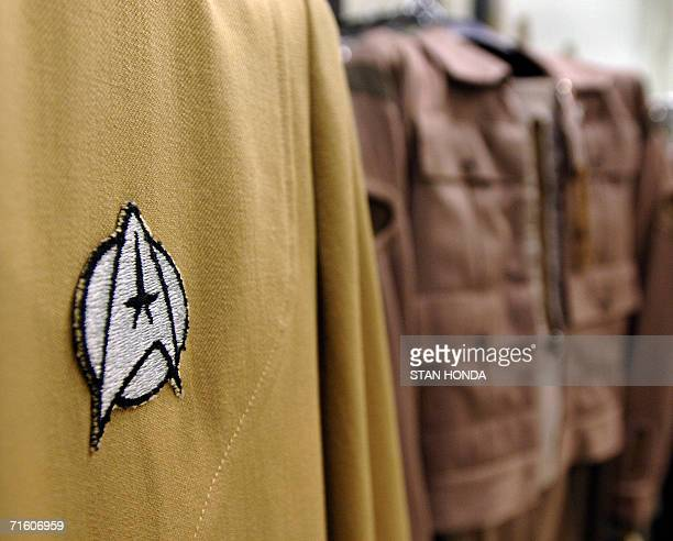 An emblem on a uniform from the Star Trek series is displayed 08 August 2006 with other costumes during a preview by Christie's at a warehouse in the...