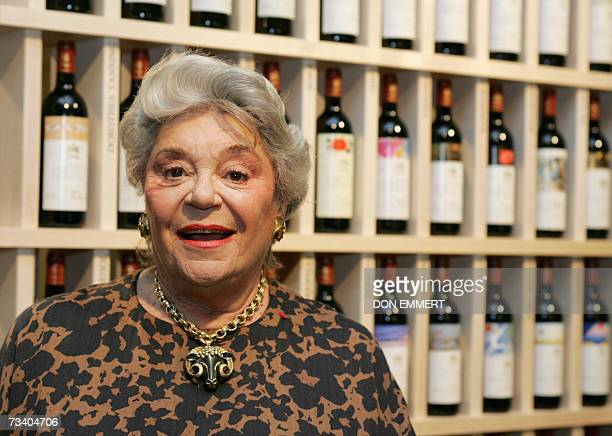 Baroness Philippine de Rothschild poses in front of bottles of Chateau Mouton Rothschild 23 February 2007 at Sotheby's in New York AFP PHOTO/DON...