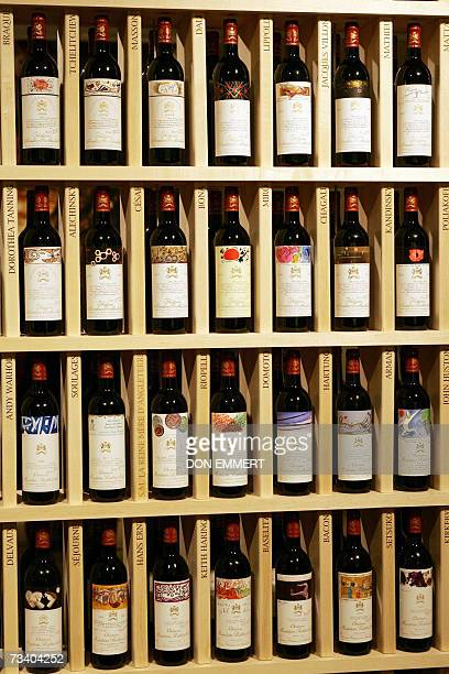 Bottles of Chateau Mouton Rothschild are viewed 23 February 2007 at Sotheby's in New York The exhibit of labels using famous paintings has 60...