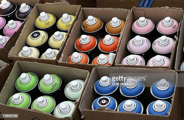 Cans of spray paint wait to be used by graffiti artists as they paint on a replica of a subway car as part of an Adidas advertising campaign 10 April...