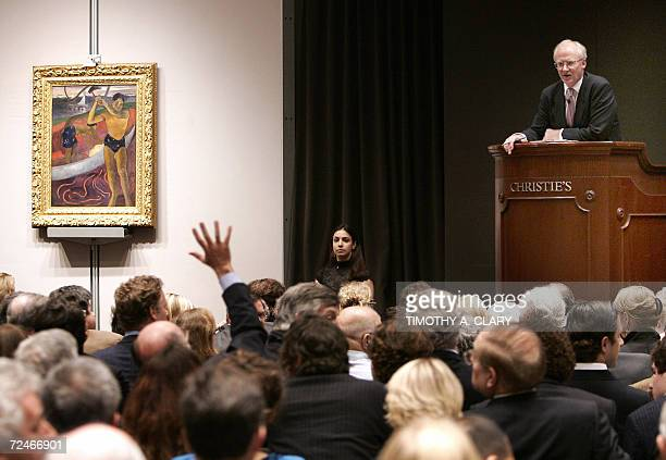 Christie's auctioneer Christopher Burge takes bids on Paul Gauguin's 'L'Homme a la hache' during the Christie's Impressionist and Modern Art Evening...