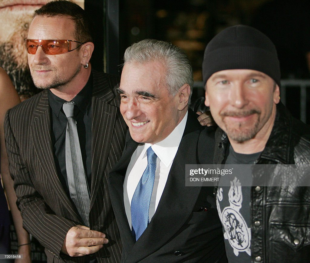 Director Martin Scorsese (C) poses with singer Bono (L) and guitarist the Edge of the band U2 as they arrive for the Warner Bros. Pictures premiere of 'The Departed' at the Ziegfeld Theatre 26 September 2006 in New York.