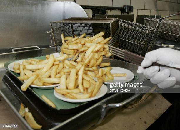 French fried potatoes cooked in trans fatfree soybean oil are ready to serve 28 June 2007 at Katz's Delicatessen on the Lower East Side of New York...