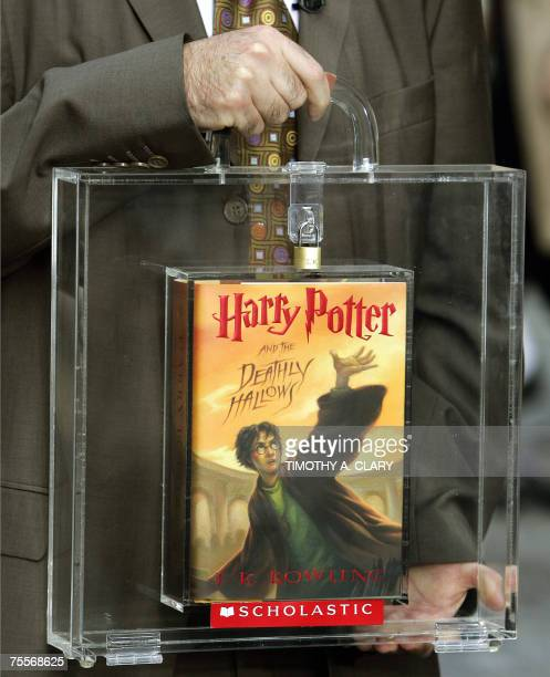 Harry Potter publisher Arthur Levine holds a locked copy of the novel 'Harry Potter and the Deathly Hallows' during a press conference at Harry...
