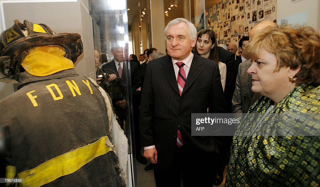 Irish Prime Minister Bertie Ahern looks over a display of a firefighter's uniform during a tour of the Tribute World Trade Center Visitors Center...