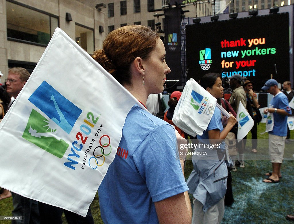 NYC2012 volunteer Michele Eggers stands silently after the New York City Olympic bid to host the 2012 Olympics is voted out in the second ballot as a...