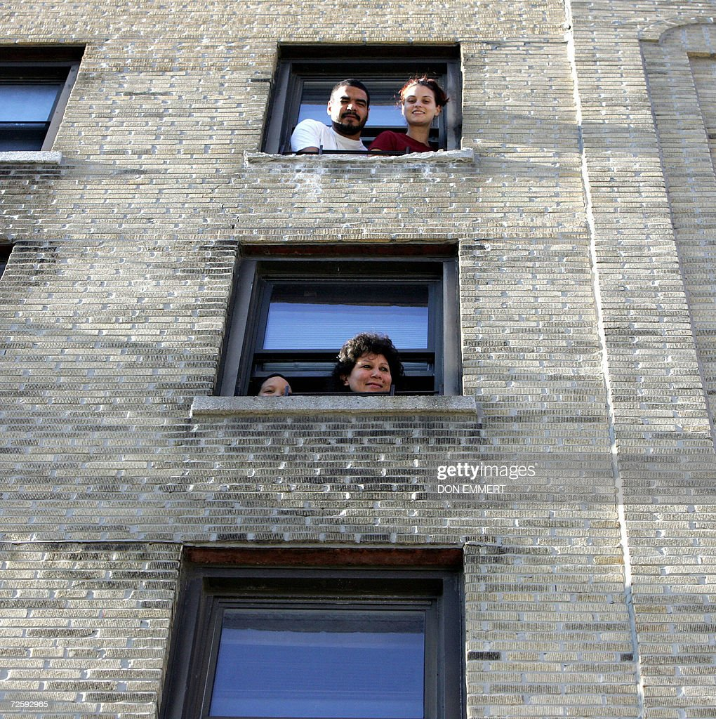 Residents of a cooperative apartment building listen to political speeches as low cost heating oil was being delivered to their cooperative apartment building 17 November, 2006 in the Bronx. The delivery was the initial low-cost heating oil of the CITGO-Venezuela heating oil program to the 60-unit building. AFP PHOTO/DON EMMERT