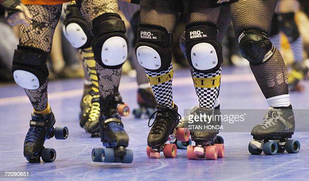 Roller derby skaters from the Bronx Gridlock and the Manhattan Mayhem at the start of action during the season opening game 06 May at the Brooklyn...